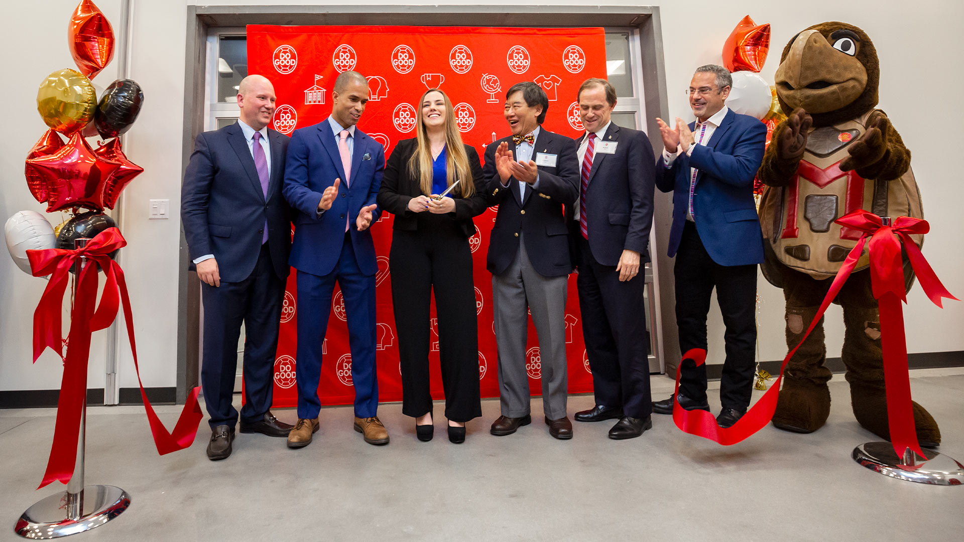 The ribbon flutters to the floor at the grand opening of the Do Good Accelerator last night. From left, Bob Grimm, Levenson Family Chair in Philanthropy and Nonprofit Leadership and Do Good Institute director, Khalil Kettering M.P.M. '15, CEO, District Stormwater and Do Good Council member, (holding scissors) Natalia Ochman '19, founder of FLAME, UMD President Wallace D. Loh, School of Public Policy Dean Robert Orr and David Rothschild, CEO of Rothschild Capital Partners. (Photo by Stephanie S. Cordle)