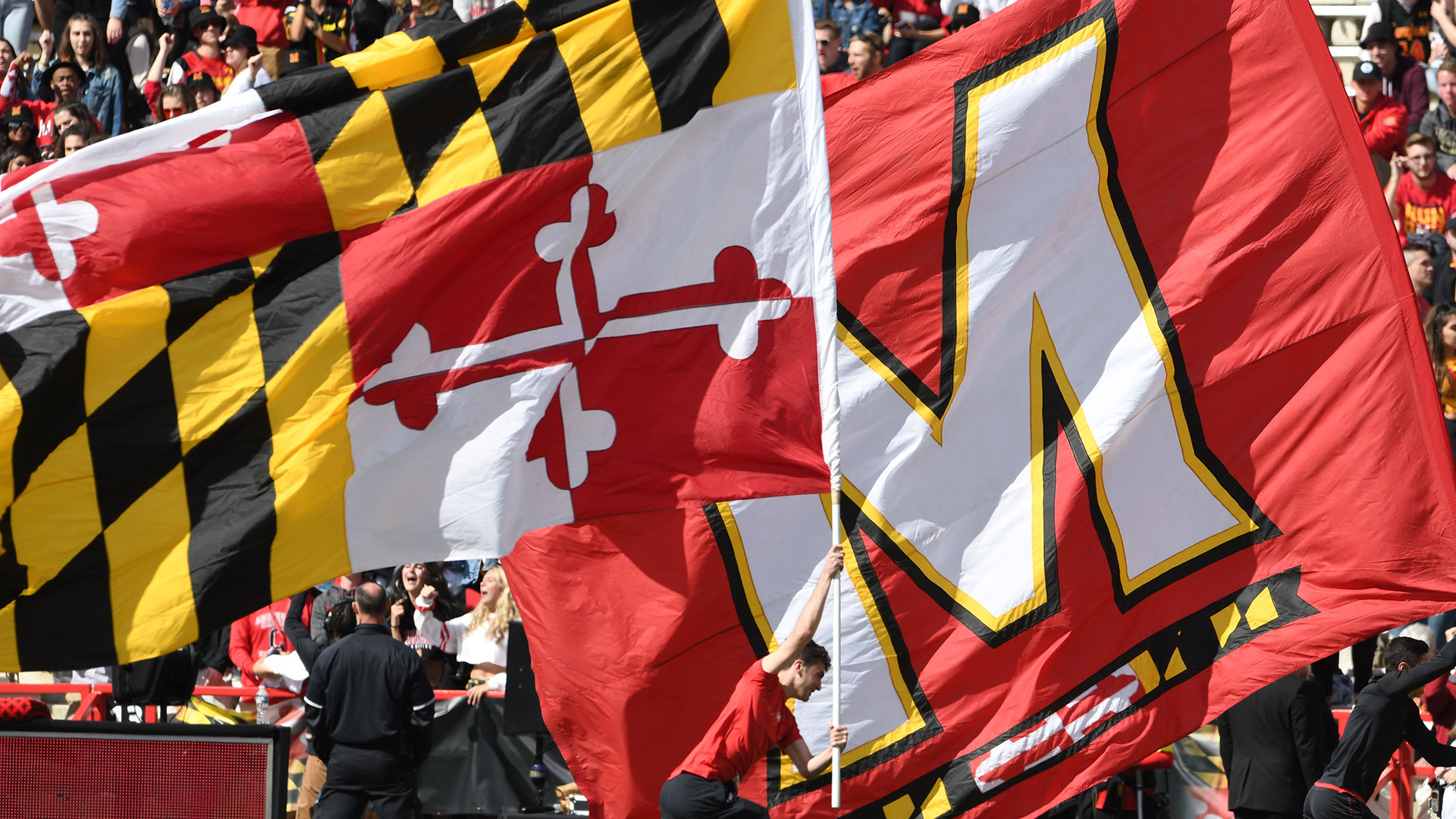 """Maryland State Flag and Maryland """"M"""" Athletics Flag flown at Homecoming Game"""