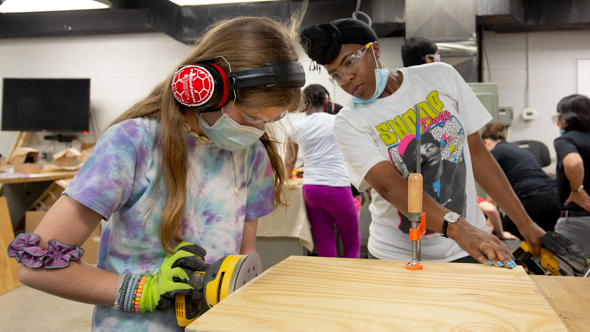 Counselor Brianna Williams (right), a student at the University of Maryland Eastern Shore, supervises Lydia Cashin, 12, of Bethesda, Md., as they build Free Little Libraries during the M-Power Tools summer day camp this week. (Photos by Stephanie S. Cordle)